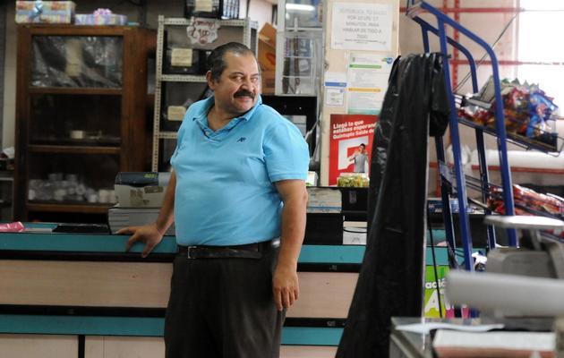 Le commerçant Federico Aguiar dans son magasin à Tegucigalpa le 31 mai 2013 [Orlando Sierra / AFP]