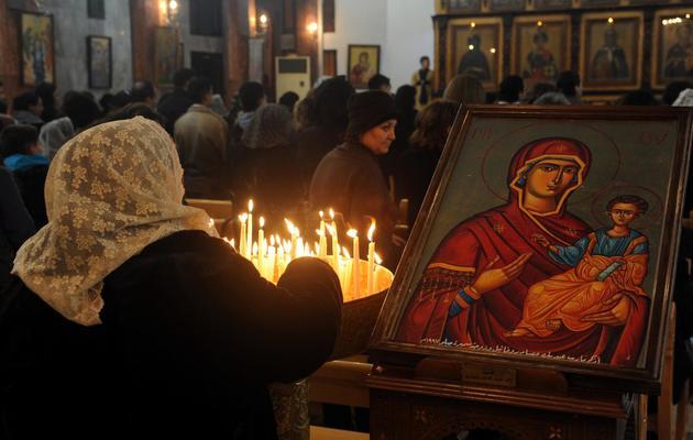 Célébration de la messe de Noël dans une église orthodoxe de Damas, le 24 décembre 2012 [ / AFP]