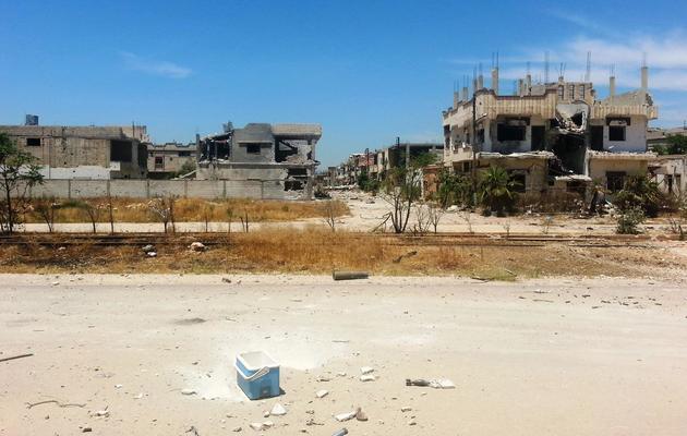 Des bâtiments détruits par les combats le 23 mai 2013 à Qousseir [Sarkis Kassargian / AFP/Archives]