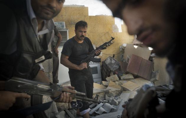 Des rebelles syriens le 27 mai 2013 dans la ville d'Alep, au nor de la Syrie [Ricardo Garcia Vilanova / AFP]