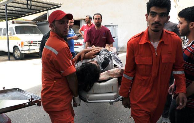 Un blessé syrien à son arrivée le 9 juin 2013 à l'hôpital de Minié, dans le nord du Liban [- / AFP]