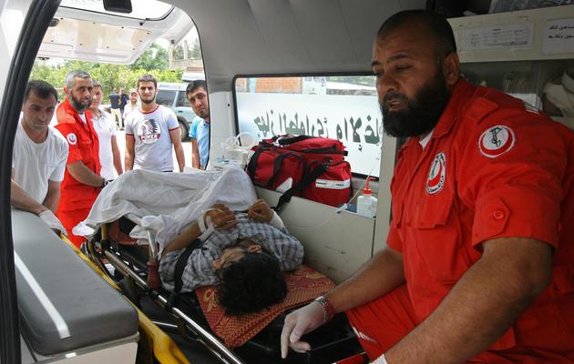 Un blessé syrien amené le 9 juin 2013 à l'hôpital de Minié, dans le nord du Liban [ / AFP]