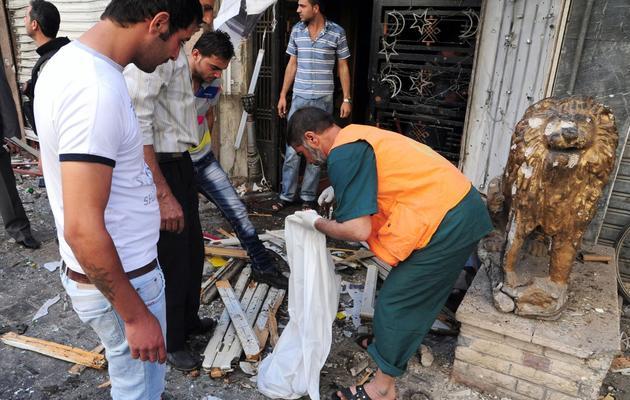 Photo fournie par l'agence officielle syrienne Sana de l'attentat commis le 11 juin 2013 à Damas [ / Sana/AFP]