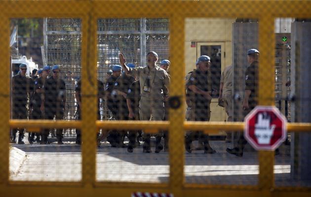 Des Casques bleus autrichiens  le 12 juin 2013 au passage de Qouneitra [Menahem Kahana / AFP]