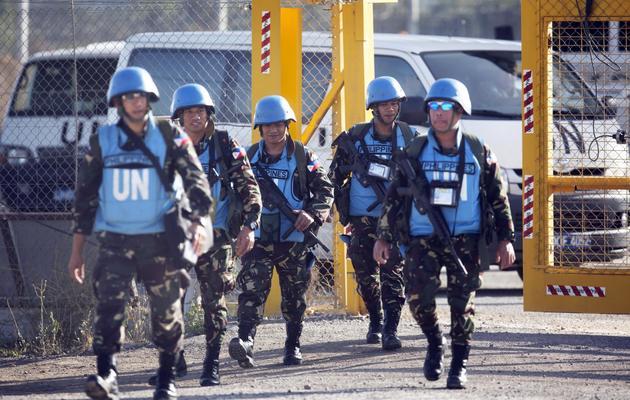 Des Casques bleus philippins photographiés le 12 juin 2013 au passage de Qouneitra, sur le Golan, [Menahem Kahana / AFP]