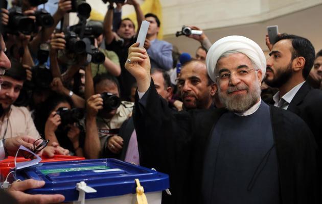 Le candidat modéré Hassan Rohani vote à Téhéran, le 14 juin 2013 [Atta Kenare / AFP]