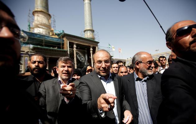 Le maire de Téhéran et candidat à la présidentielle Mohammad Bagher Ghalibaf arrive pour voter dans un bureau du sud de Téhéran, le 14 juin 2013 [Behrouz Mehri / AFP]