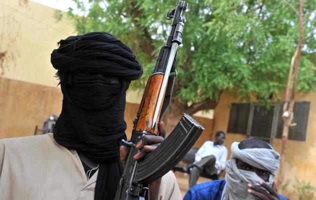 Des combattants islamistes le 12 juillet 2012 à Gao, dans le nord-est du Mali [Issouf Sanogo / AFP/Archives]