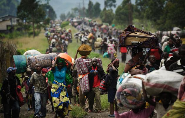 Des milliers de Congolais fuient les combats entre l'armée et la rébellion, près de Sake et Goma, le 22 novembre 2012 [Phil Moore / AFP/Archives]