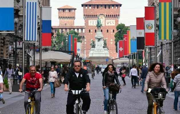 Des cyclistes dans le centre de Milan, le 22 mai 2013 [Giuseppe Cacace / AFP]