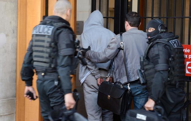 Le suspect   arrêté dans les Yvelines à son arrivée le 29 mai 2013 dans les locaux de la BRI à Paris [Eric Feferberg / AFP]