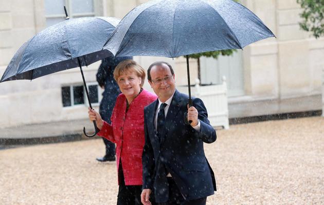 Le président français François Hollande et la chancellière allemande Angela Merkel à l'Elysée, le 30 mai 2013 [Pierre Verdy / AFP]