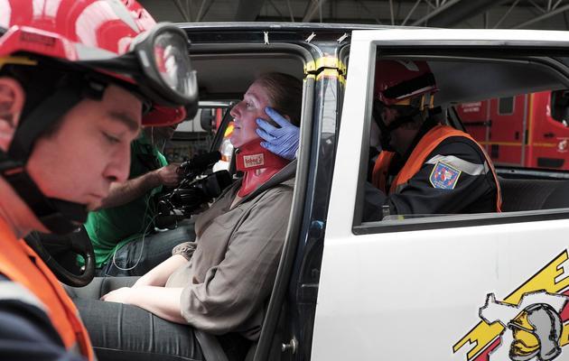 Un pompier lors d'un exercice, le 28 mai 2013 à Hagenau dans l'Est de la France [Frederick Florin / AFP]