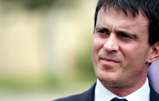 Le ministre de l'Intérieur Manuel Valls à Bastia, en Corse, le 3 juin 2013 [Pascal Pochard Casabianca / AFP]