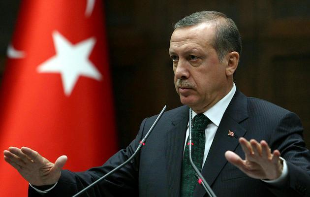 Le Premier minstre turc Recep Tayyip Erdogan s'adresse aux députés de son parti, l'AKP, au parlement à Ankara, le 11 juin 2013 [Adem Altan / AFP]