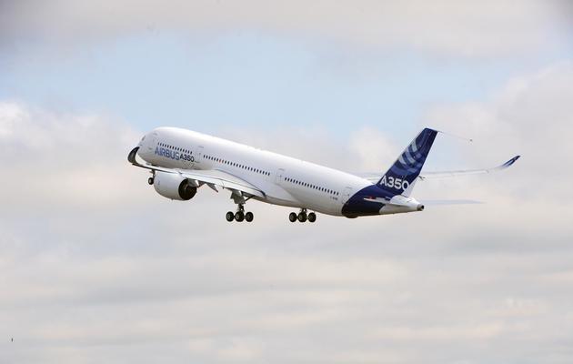 L'Airbus A350 s'élance de la piste de Toulouse-Blagnac pour son premier test de vol, le 14 juin 2013 [Eric Cabanis / AFP]