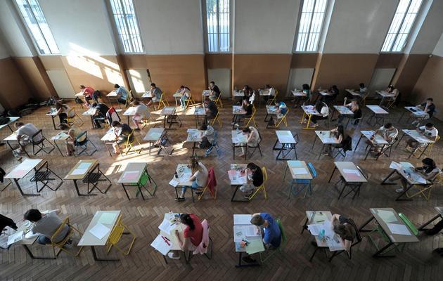 Des étudiants planchent sur leur épreuve de philosophie, le 17 juin 2013 au lycée Pasteur à Strasbourg [Frederick Florin / AFP]