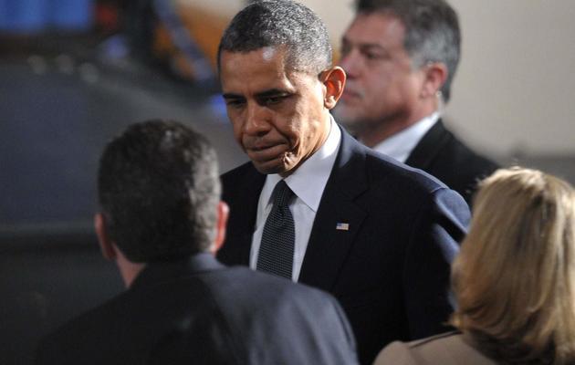Barack Obama arrive au lycée de Newtown pour une cérémonie oecuménique en souvenir des victimes du massacre de l'école Sandy Hook, le 16 décembre 2012 [Mandel Ngan / AFP]