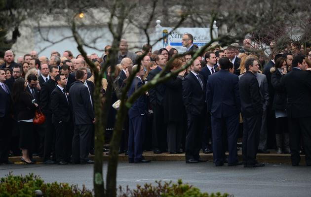 Des personnes venues pour les funérailles d'une enfant victime de la tuerie de Newtown (Connecticut), le 18 décembre 2012 [Emmanuel Dunand / AFP]