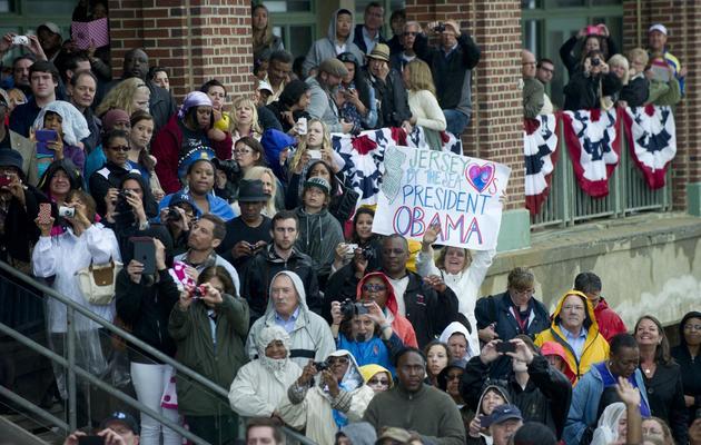 Des personnes assistent au discours que tient Barack Obama à Asbury Park dans le New Jersey, le 28 mai 2013 [Saul Loeb / AFP]