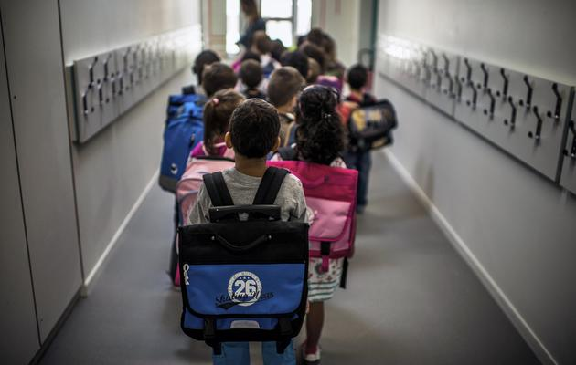 Des élèves d'une école primaire à la rentrée 2013 [Jeff Pachoud / AFP/Archives]
