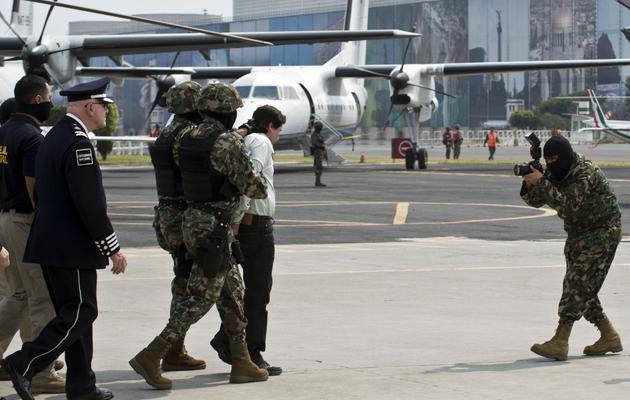 """Arrestation du trafiquant de drogue mexicain Joaquin """"Chapo"""" Guzman, le 22 février 2014 à Mexico [Ronaldo Schemidt / AFP]"""