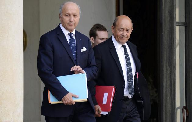 Laurent Fabius et Jean-Yves Le Drian le 28 août 2013 à l'Elysée à Paris [Bertrand Guay / AFP]
