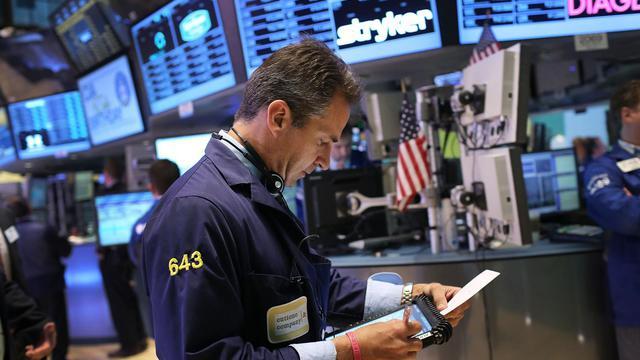 "Des traders sur le ""floor"" du New York Stock Exchange, le 18 septembre 2012 [Spencer Platt / AFP/Getty Images]"