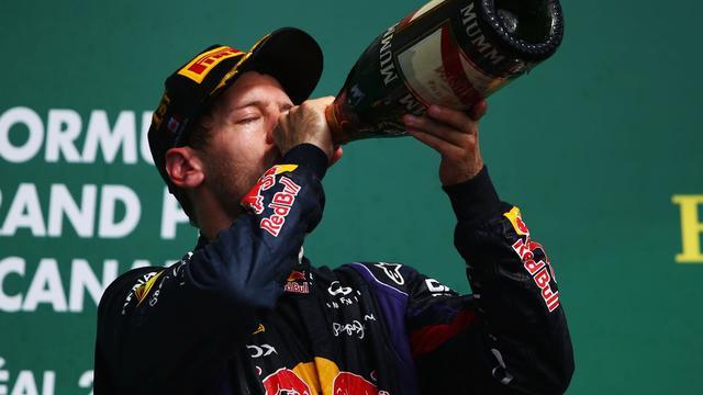 Sebastian Vettel célèbre sa victoire au GP du Canada, le 8 juin 2013 à Montréal [Paul Gilham / AFP/Getty Images]