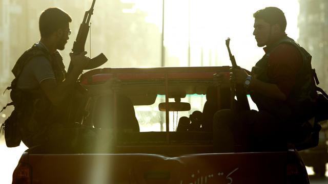 Des rebelles syriens patrouillent à Alep, le 25 septembre 2012 [Miguel Medina / AFP]