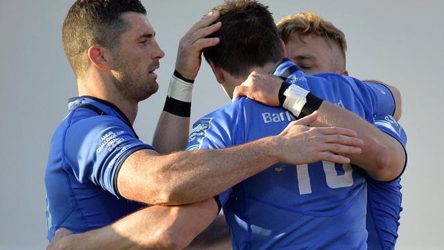 Les Irlandais du Leinster se congratulent après avoir inscrit le premier essai de la finale du Challenge contre le Stade Français, le 17 mai 2013 à Dublin [Lionel Bonaventure / AFP]