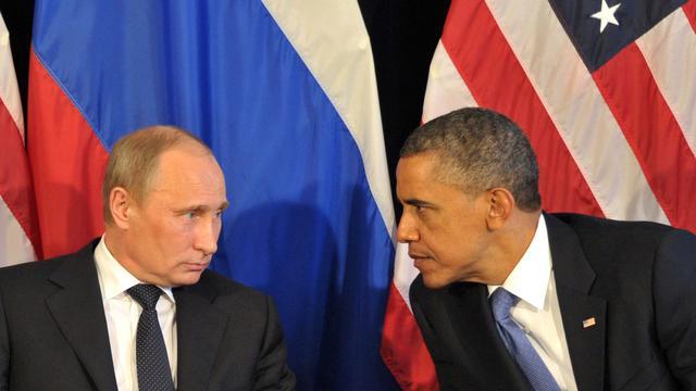 Les présidents russe Vladimir Poutine et américain Barack Obama le 18 juin 2012 à Los Cabos, au Mexique, lors du sommet du G20 [Alexei Nikolsky / Ria-Novosti/AFP/Archives]