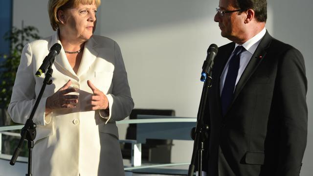 La chancelière allemande Angela Merkel et le président françaisFrançois Hollande, le 23 août 2012 à Berlin [John Macdougall / AFP/Archives]