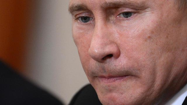 Le président Vladimir Poutine s'en est pris aux Pussy Riot, a défendu Julian Assange et balayé les appels lancés à son pays pour qu'il change de position sur la Syrie, dans un entretien diffusé jeudi sur la chaîne publique russe en anglais Russia Today. [AFP POOL]