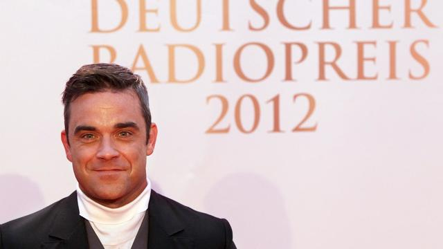 La start de la pop britannique Robbie Williams, le 6 septembre 2012, à Hambourg, avant de recevoir un prix [Malte Christians / DPA/AFP/Archives]