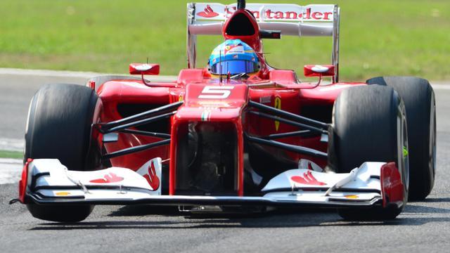 """L'avance de Fernando Alonso en tête du Championnat de F1 est désormais de 37 points sur Hamilton, au lieu de 24 points sur Vettel avant Monza. """"C'était un dimanche parfait"""", a-t-il résumé [AFP]"""