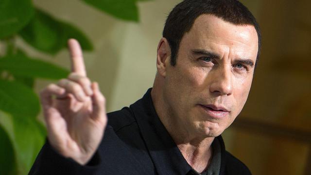 """John Travolta le 17 septembre 2012 lors de la présentation de """"Savages"""" à Berlin [Hannibal Hanschke / AFP/Archives]"""