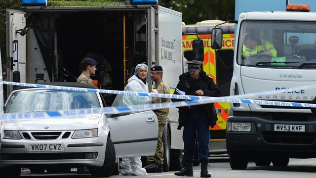 Des officiers de police à l'endroit où deux policières ont été tuées à Manchester, le 18 septembre 2012 [Andrew Yates / AFP]
