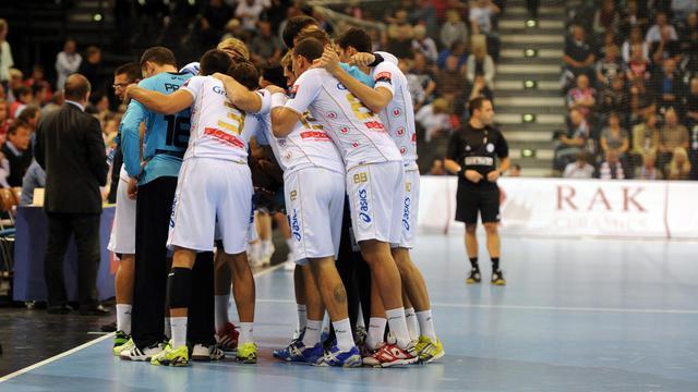 Les joueurs de Montpellier, lors d'un temps mort pendant leur match de Ligue des champions à Flensburg (Allemagne), le 27 septembre 2012. [Benjamin Nolte / AFP]