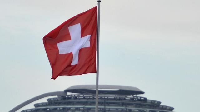 Le drapeau suisse [Odd Andersen / AFP/Archives]