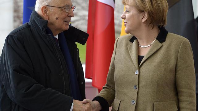 Le président italien Giorgio Napolitano et la chancelière allemande Angela Merkel, le 28 février 2013 à Berlin [Odd Andersen / AFP]
