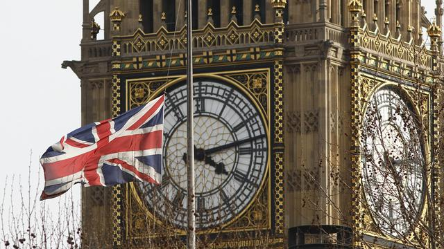 Un drapeau britannique devant la tour de Big Ben à Londres [Justin Tallis / AFP/Archives]
