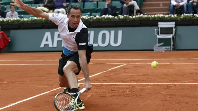 Le Français Michael Llodra lors de son match en simple contre le Candien Milos Raonic à Roland-Garros, le 29 mai 2013 [Thomas Coex / AFP/Archives]