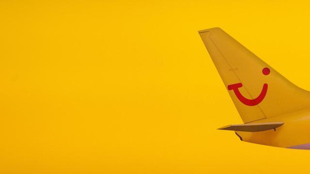 Le logo de TUI Travel sur un avion, à l'aéroport Tegel de Berlin, le 4 février 2011 [Lukas Kreibig / AFP/Archives]