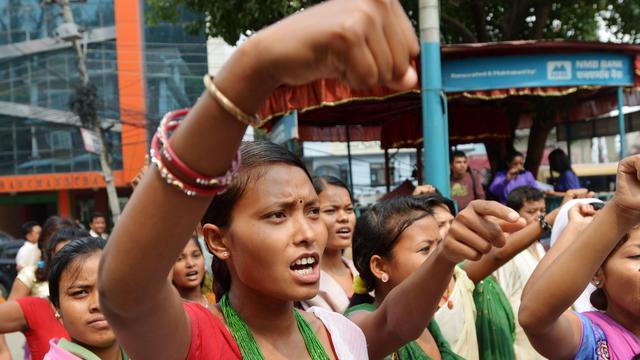 D'anciennes victimes du travail forcé au Népal défilent, le 4 juin 2013 dans les rues de Katmandou [Prakash Mathema / AFP/Archives]