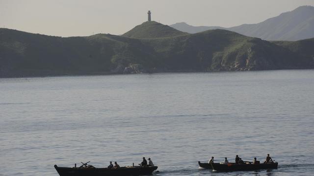Des pêcheurs nord-coréens, photographiés en août 2011 [Goh Chai Hin / AFP/Archives]