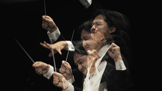 Le chef japonais Yuki Kakiuchi dirige l'orchestre philharmonique de Bruxelles, le 24 septembre 2011 à Besançon [Jeff Pachoud / AFP/Archives]