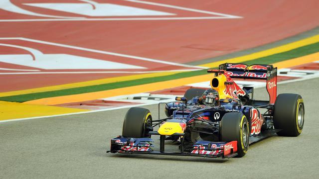 L'Allemand Sebastian Vettel au volant de sa monoplace Red Bull au cours de la 3e séance d'essais libres du GP de Singapour, le 22 septembre 2012. [Punit Paranjpe / AFP]