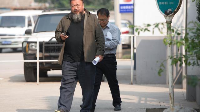 Ai Weiwei le 27 septembre 2012 à la sortie du tribunal à Pékin [Ed Jones / AFP]