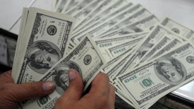 Des dollars [Noel Celis / AFP/Archives]
